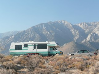 Motorhome and car w eastern sierras background