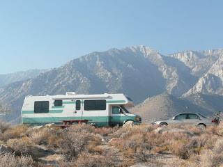 Motorhome and car w eastern sierras background